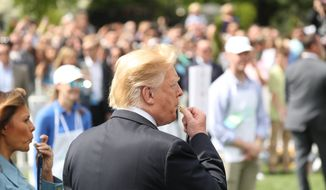 President Donald Trump, joined by first lady Melania Trump, left, blow whistles to start the annual White House Egg Roll, Monday, April 22, 2019, at the White House in Washington. (AP Photo/Andrew Harnik)
