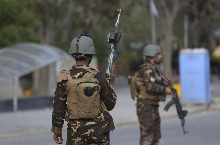 Afghan Security personnel arrive outside the Telecommunication Ministry during a gunfight with insurgents in Kabul, Afghanistan, Saturday, April 20, 2019. A suicide blast rocked Afghanistan's capital Saturday during a gun battle with security forces, officials said, killing several people a day after hopes for all-encompassing peace talks collapsed.  (AP Photo/Rahmat Gul)