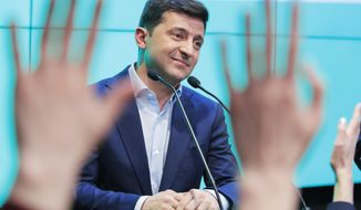 Ukrainian comedian and presidential candidate Volodymyr Zelenski speaks to his supporters at his headquarters after the second round of presidential elections in Kiev, Ukraine, Sunday, April 21, 2019. Ukrainians voted on Sunday in a presidential runoff as the nation's incumbent leader struggles to fend off a strong challenge by a comedian who denounces corruption and plays the role of president in a TV sitcom. (AP Photo/Vadim Ghirda)