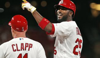 St. Louis Cardinals' Dexter Fowler (25) celebrates after hitting an RBI-single during the seventh inning of a baseball game against the Milwaukee Brewers, Monday, April 22, 2019, in St. Louis. (AP Photo/Jeff Roberson)