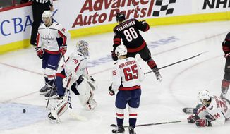 Carolina Hurricanes' Teuvo Teravainen (86), of Finland, reacts following a goal against Washington Capitals goalie Braden Holtby (70) during the second period of Game 6 of an NHL hockey first-round playoff series in Raleigh, N.C., Monday, April 22, 2019. Capitals' Andre Burakovsky (65), of Austria, and John Carlson (74) look on with Capitals' Jonas Siegenthaler (34), of the Czech Republic. (AP Photo/Gerry Broome)