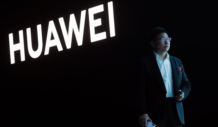 FILE - In this March 26, 2019, file photo, Huawei CEO Richard Yu stands during the presentation of the new Huawei P30 smartphone, in Paris. Chinese tech giant Huawei said Monday, April 22, 2019, its revenue rose 39 percent over a year earlier in the latest quarter despite U.S. pressure on allies to shun its telecom and network technology as a security risk. (AP Photo/Thibault Camus, File)