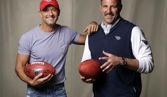 CORRECTS TO THE SECOND DAY OF THE NFL DRAFT, ON APRIL 26 - In this April 18, 2019, photo, country music star Tim McGraw, left, poses with Tennessee Titans head coach Mike Vrabel in Nashville, Tenn. After the second day of the of the NFL Draft in Nashville on Friday, April 26, McGraw will cap off the evening performing on the draft stage across the Cumberland River from Nissan Stadium, home of the Tennessee Titans. (AP Photo/Mark Humphrey)