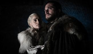 """This image released by HBO shows Emilia Clarke and Kit Harington in a scene from """"Game of Thrones,"""" that aired Sunday, April 21, 2019. With the Game of Thrones' Jon Snow revealing his royal lineage to his potential rival Daenerys Targaryen, the beleaguered army at Winterfell is about to find out if two chief executives better than one. (Helen Sloan/HBO via AP)"""