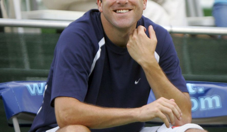 FILE - In this July 23, 2008, file photo, Justin Gimelstob, then a member of Kastles' World Team Tennis, smiles during a match in Washington. Now a tennis broadcaster and coach, Gimelstob pleaded no contest to misdemeanor assault for attacking a former friend in Los Angeles on Halloween 2017. The district attorney's office says the 42-year-old former pro player was sentenced Monday, April 22, 2019, to three years of probation, 60 days of community service and a year's worth of anger management classes. (AP Photo/Lawrence Jackson, File)