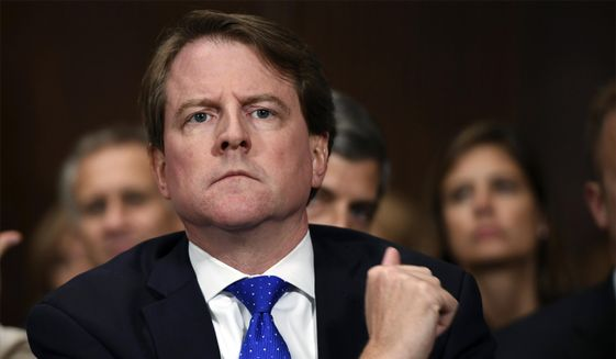 In this Sept. 27, 2018, photo, then-White House counsel Don McGahn listens as Supreme court nominee Brett Kavanaugh testifies before the Senate Judiciary Committee on Capitol Hill in Washington. Rep. Jerrold Nadler, the chairman of the House Judiciary Committee has subpoenaed McGahn for testimony following the release of the report from special counsel Robert Mueller. (Saul Loeb/Pool Photo via AP) ** FILE **