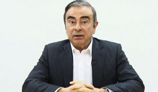 In this image made from video released by Carlos Ghosn via his lawyer on April 9, 2019, former Nissan chairman Ghosn speaks on camera in Tokyo. Japanese media reported Monday, April 22, 2019 that Ghosn was indicted on new breach of trust charges. (Carlos Ghosn via AP)