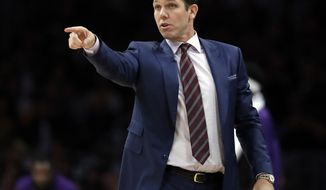 FILE - In this Oct. 20, 2018, file photo, Los Angeles Lakers head coach Luke Walton directs his team during the second half of an NBA basketball game against the Houston Rockets in Los Angeles. A person with direct knowledge of the agreement said Saturday, April 13, 2019, that Walton will become coach of the Sacramento Kings, just a day after parting ways with the Lakers following three losing seasons.   (AP Photo/Marcio Jose Sanchez) ** FILE **