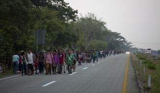 Central American migrants traveling in a caravan to the U.S. border walk on a road in Pijijiapan, Mexico, Monday, April 22, 2019. The outpouring of aid that once greeted Central American migrants as they trekked in caravans through southern Mexico has been drying up, so this group is hungrier, advancing slowly or not at all, and hounded by unhelpful local officials. (AP Photo/Moises Castillo) ** FILE **
