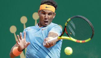 Spain's Rafael Nadal returns the ball toItaly's Fabio Fognini during their semifinal match of the Monte Carlo Tennis Masters tournament in Monaco, Saturday, April, 20, 2019. (AP Photo/Claude Paris)