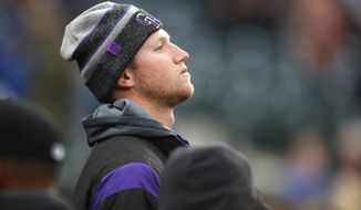 Colorado Rockies starting pitcher Kyle Freeland looks on from the dugout in the first inning of a baseball game against the Washington Nationals, Monday, April 22, 2019, in Denver. Freeland was put on the injured list Monday. (AP Photo/David Zalubowski)
