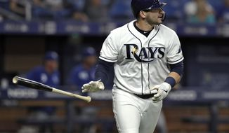 Tampa Bay Rays Mike Zunino drops his bat after hitting a two-run home run off Kansas City Royals pitcher Brad Keller during the seventh inning of a baseball game Monday, April 22, 2019, in St. Petersburg, Fla. (AP Photo/Chris O'Meara)
