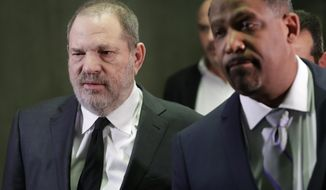 FILE - In this Jan. 25, 2019, file photo, Harvey Weinstein, left, leaves court with attorney Ron Sullivan in New York. Both sides in Harvey Weinstein's sexual assault case want the media and the public barred from the disgraced movie mogul's next court appearance. News organizations including Thee Associated Press are fighting to keep the hearing open plan to file a petition Monday, April 22, with the court. (AP Photo/Mark Lennihan, File)