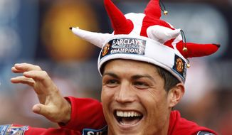 FILE - In this Saturday May 16, 2009 file photo, Manchester United's Cristiano Ronaldo smiles as the team celebrate winning the English Premier League after their 0-0 draw against Arsenal at Old Trafford Stadium, Manchester, England. Ronaldo, who joined Juventus for this season from Real Madrid, became the first player to win the English Premier League (with Manchester United), the Spanish league (with Madrid) and Serie A. (AP Photo/Jon Super, File)