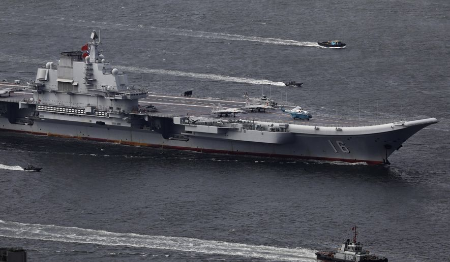 In this July 7, 2017, photo, the Liaoning, China's first aircraft carrier, sails into Hong Kong for a port call to celebrate the 20th anniversary of the People's Liberation Army (PLA) garrison's presence in the semi-autonomous Chinese city and former British colony. (AP Photo/Vincent Yu) **FILE**