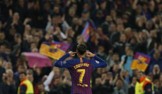 Barcelona forward Philippe Coutinho gestures after scoring his side's third goal during the Champions League quarterfinal, second leg, soccer match between FC Barcelona and Manchester United at the Camp Nou stadium in Barcelona, Spain, Tuesday, April 16, 2019. (AP Photo/Joan Monfort)