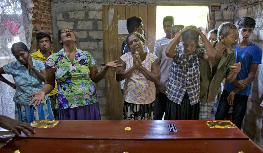 Relatives weep near the coffin with the remains of 12-year Sneha Savindi, who was a victim of Easter Sunday bombing at St. Sebastian Church, Monday, April 22, 2019 in Negombo, Sri Lanka. Sri Lankan authorities blame seven suicide bombers of a domestic militant group for coordinated Easter bombings that ripped through Sri Lankan churches and luxury hotels which killed and injured hundreds of people. It was Sri Lanka's deadliest violence since a devastating civil war in the South Asian island nation ended a decade ago. (AP Photo/Gemunu Amarasinghe)