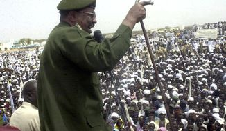 FILE - In this May 19, 2004 file photo, then Sudanese President Omar al-Bashir speaks to thousands of Sudanese in Nyala, capital of the country's southern Darfur state. Al-Bashir, driven from power in April 2019, and now languishing in a prison where his opponents were once jailed and tortured, is more vulnerable than ever to a decade-old international arrest warrant for war crimes committed in Darfur. But the military, which forced him from power after four months of mass protests, has said it will not extradite him to the International Criminal Court at the Hague. (AP Photo/Abd Raouf, File)