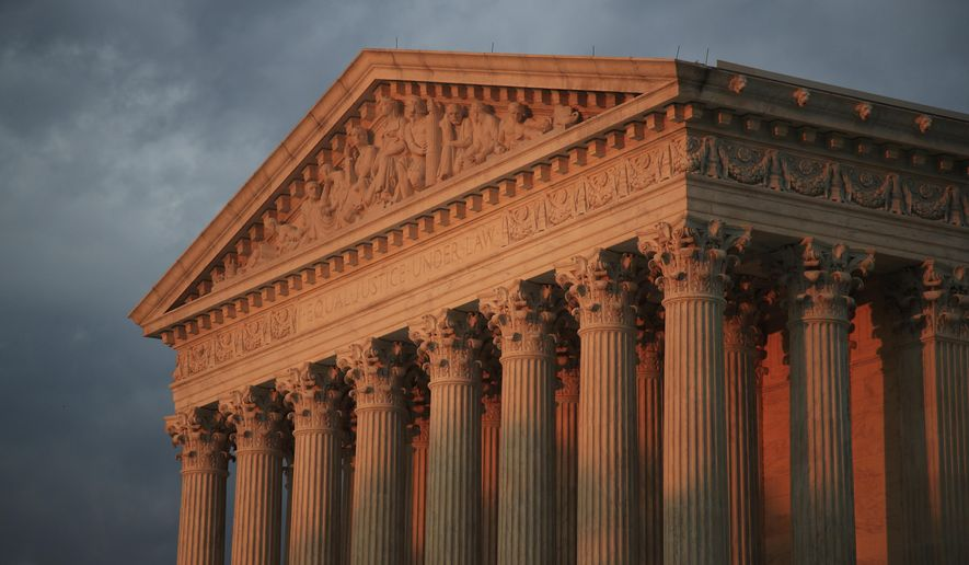 In this Oct. 4, 2018, file photo, the U.S. Supreme Court is seen at sunset in Washington. The Supreme Court will decide whether the main federal civil rights law that prohibits employment discrimination applies to LGBT people. The justices say Monday they will hear cases involving people who claim they were fired because of their sexual orientation. (AP Photo/Manuel Balce Ceneta) ** FILE **
