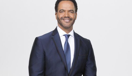 """This image released by CBS shows Kristoff St. John who portrays Neil Winters on the CBS series """"The Young and the Restless.""""   St. John, who died at age 52 in February of heart disease, helped cement the prominence of major African-American characters in the traditionally white soap opera world. (Sonja Flemming/CBS via AP)"""