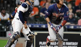 Minnesota Twins' Jorge Polanco, right, watches his two-run home run off Houston Astros relief pitcher Chris Devenski during the eighth inning of a baseball game, Monday, April 22, 2019, in Houston. (AP Photo/Eric Christian Smith)