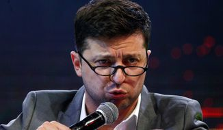 FILE - In this Friday, March 29, 2019 file photo, Volodymyr Zelenskiy, Ukrainian actor and candidate in the upcoming presidential election, hosts a comedy show at a concert hall in Brovary, Ukraine. For his presidential campaign popular Ukrainian comedian Volodymyr Zelenskiy has literally taken the script from a TV show in which he plays the Ukrainian president. (AP Photo/Efrem Lukatsky, file)