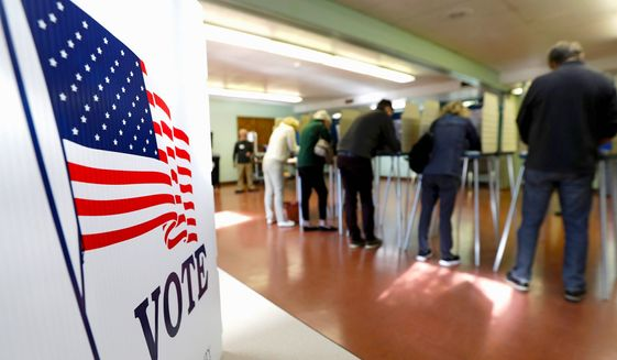 Voters cast their ballots, Tuesday, Nov. 6, 2018, in Gates Mills, Ohio. (Associated Press) ** FILE **