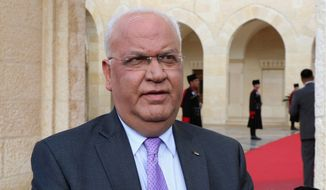 Saeb Erekat, an aide to Palestinian President Mahmoud Abbas, speaks to journalists after a meeting between Abbas and Jordan's King Abdullah II, at the Royal Palace, in Amman, Jordan, Monday, Jan. 29, 2018. (Khalil Mazraawi, Pool Photo via AP) ** FILE **