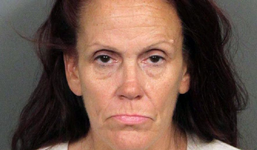 This booking photo released by Riverside County Animal Services on Tuesday, April 23, 2019, shows Deborah Sue Culwell. The California woman could face up to seven years behind bars on a slew of charges filed Tuesday after authorities say surveillance video showed her casually tossing a bag of 3-day-old, palm-sized puppies into a trash can on a sweltering day. (Riverside County Animal Services via AP)