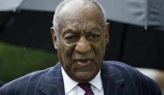 FILE - In this Sept. 25, 2018, file photo, Bill Cosby arrives for his sentencing hearing at the Montgomery County Courthouse in Norristown Pa. A fee dispute between Cosby and a Los Angeles law firm shows the firm billed him about $1 million a month in the run-up to his first sex assault trial. The 81-year-old Cosby is challenging a California arbitration award that trims the $9 million bill from Quinn Emanuel Urquhart and Sullivan to below $7 million. (AP Photo/Matt Rourke, File)