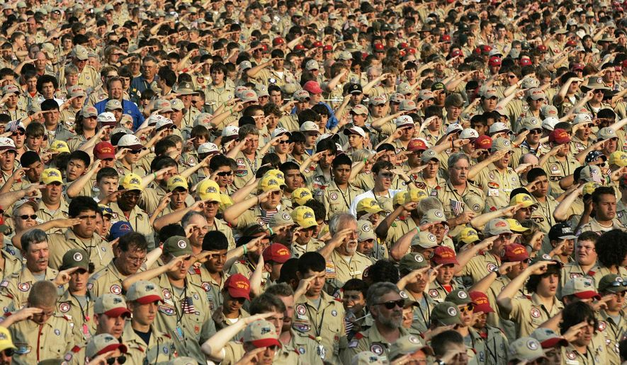 In this July 31, 2005 file photo, Boy Scouts salute as they recite the Pledge of Allegiance during the Boy Scout Jamboree in Bowling Green, Va.  (AP Photo/ Haraz N. Ghanbari) **FILE**