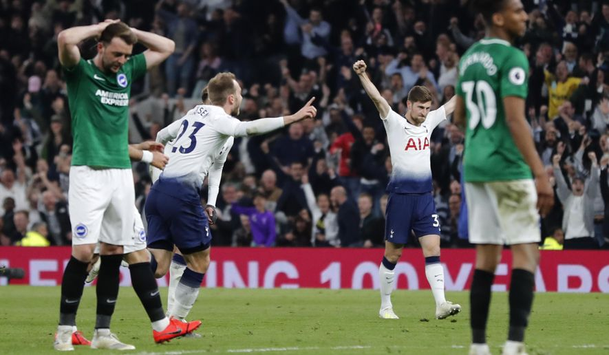 Tottenham's Christian Eriksen, second left, celebrates scoring his side's first goal during the English Premier League soccer match between Tottenham Hotspur and Brighton & Hove Albion at Tottenham Hotspur stadium in London, Tuesday, April 23, 2019.(AP Photo/Frank Augstein)