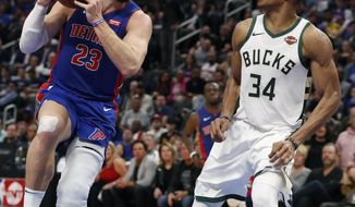 Detroit Pistons forward Blake Griffin (23) attempts a layup as Milwaukee Bucks forward Giannis Antetokounmpo (34) defends during the second half of Game 4 of a first-round NBA basketball playoff series, Monday, April 22, 2019, in Detroit. (AP Photo/Carlos Osorio)