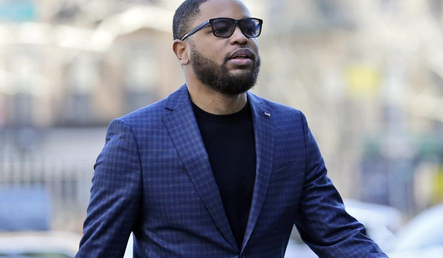 FILE - In this March 5, 2019, file photo, Christian Dawkins arrives at federal court in New York. A prosecutor says greed led a fledgling manager of basketball players to bribe college coaches but defense lawyers say it was all an FBI setup. The characterizations came during opening statements Tuesday, April 23, 2019, in the second trial to result from a prosecution that has exposed a seedy side of college basketball recruitment. On trial are business manager Christian Dawkins and ex-amateur league director Merl Code. (AP Photo/Seth Wenig, File)