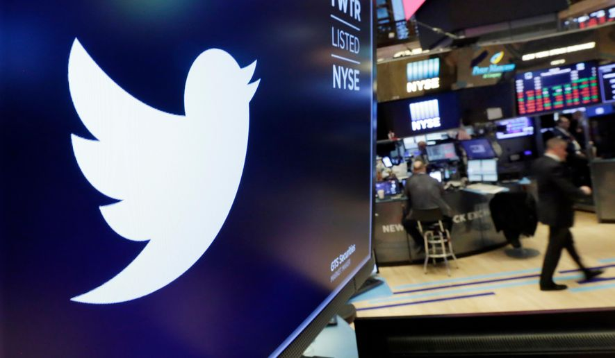 The logo for Twitter is displayed above a trading post on the floor of the New York Stock Exchange. (AP Photo/Richard Drew, File)