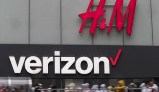 FILE - In this May 16, 2018, file photo the Verizon logo hangs on a building on 34th Street in New York. Verizon Communications Inc. reports financial results Tuesday, April 23, 2019. (AP Photo/Mary Altaffer, File)