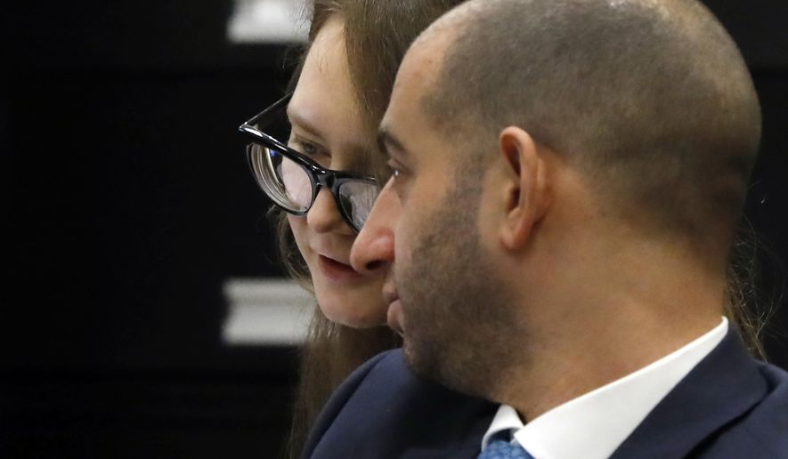 Anna Sorokin, and her attorney Todd Spodek, confer during her trial at New York State Supreme Court, in New York, Monday, April 22, 2019. Sorokin, who claimed to be a German heiress, is on trial on grand larceny and theft of services charges. (AP Photo/Richard Drew)