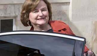 FILE - In this March 20, 2019 file photo, then French Minister of European Affairs Nathalie Loiseau gets into her car as she leaves the the weekly cabinet meeting at the Elysee Palace in Paris. Loiseau, who leads French president Emmanuel Macron's party in the May EU parliament elections, is facing criticism after online media Mediapart revealed she featured on a list alongside far-right candidates at a student's election 35 years ago. (AP Photo/Michel Euler, File)