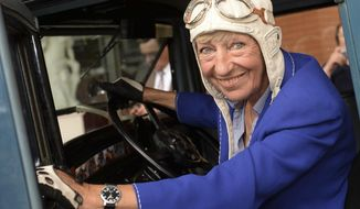 FILE-In this July 24, 2014 file photo Heidi Hetzer poses at a Hudson Great Eight Oldtimer (1930) in Berlin, Germany. Businesswoman Heidi Hetzer, whose late-in-life decision to drive around the world in an American vintage car won her many fans back home in Germany, has died. (Britta Pedersen/dpa via AP)