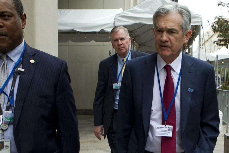 Federal Reserve Board Chair Jerome Powell accompanied by his security detail, leaves after attending a G20 meeting at the World Bank/IMF Spring Meetings in Washington, Thursday, April 11, 2019. (AP Photo/Jose Luis Magana)