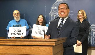 Minnesota Attorney General Keith Ellison speaks at a news conference at the state Capitol in St. Paul, Minnesota, Tuesday, April 23, 2019, about the impact of a 2017 state law repealing the state's ban on for-profit health insurance companies. (AP Photo/Steve Karnowski) **FILE**