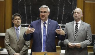 Indiana Gov. Eric Holcomb speaks during a news conference in the House chamber at the Statehouse, Tuesday, April 23, 2019, in Indianapolis. (AP Photo/Darron Cummings)