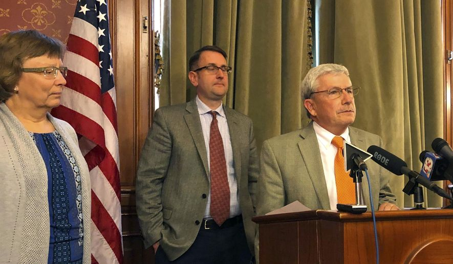Iowa Rep. Andy McKean, right, the longest-serving Republican in the Iowa Legislature says he's becoming a Democrat during a news conference at the Statehouse in Des Moines, Tuesday, April 23, 2019. (AP Photo/David Pitt)