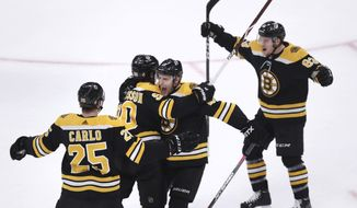 Boston Bruins left wing Marcus Johansson, second from left, is congratulated by teammates after his goal off Toronto Maple Leafs goaltender Frederik Andersen during the first period of Game 7 of an NHL hockey first-round playoff series, Tuesday, April 23, 2019, in Boston. (AP Photo/Charles Krupa)