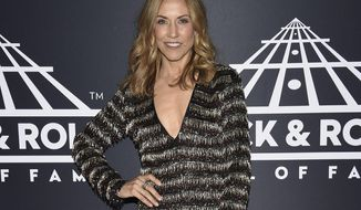 """FILE - This March 29, 2019 file photo shows Sheryl Crow attending the Rock & Roll Hall of Fame induction ceremony in New York.  Crow has released """"Redemption Day,"""" a political and spiritual song about war featuring vocals from the late Johnny Cash that will be featured on what she says is her last album. The song is from her upcoming album for Valory Music Co., which will also include duets with Keith Richards, Stevie Nicks and Eagles members Don Henley and Joe Walsh among others. No release date for the album has been announced. (Photo by Evan Agostini/Invision/AP, File)"""
