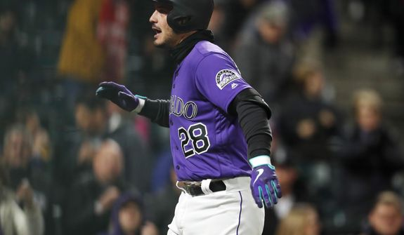 Colorado Rockies' Nolan Arenado celebrates after hitting a solo home run off Washington Nationals relief pitcher Wander Suero in the seventh inning of a baseball game Monday, April 22, 2019, in Denver. (AP Photo/David Zalubowski)