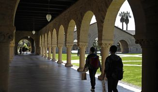 FILE - In this March 14, 2019, file photo, people walk on the Stanford University campus in Santa Clara, Calif. Whether you're asking your parents for financial help, or they're offering it, think twice before accepting. If Mom and Dad aren't on track for retirement, it could end up costing everyone. (AP Photo/Ben Margot, File)