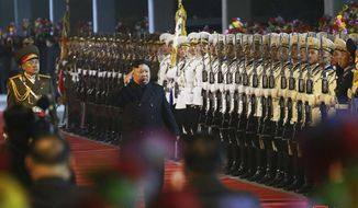 "In this photo provided by the North Korean government, North Korean leader Kim Jong Un inspects an honor guard at an undisclosed train station in North Korea on Wednesday, April 24, 2019, before leaving for Russia. Independent journalists were not given access to cover the event depicted in this image distributed by the North Korean government. The content of this image is as provided and cannot be independently verified. Korean language watermark on image as provided by source reads: ""KCNA"" which is the abbreviation for Korean Central News Agency. (Korean Central News Agency/Korea News Service via AP)"