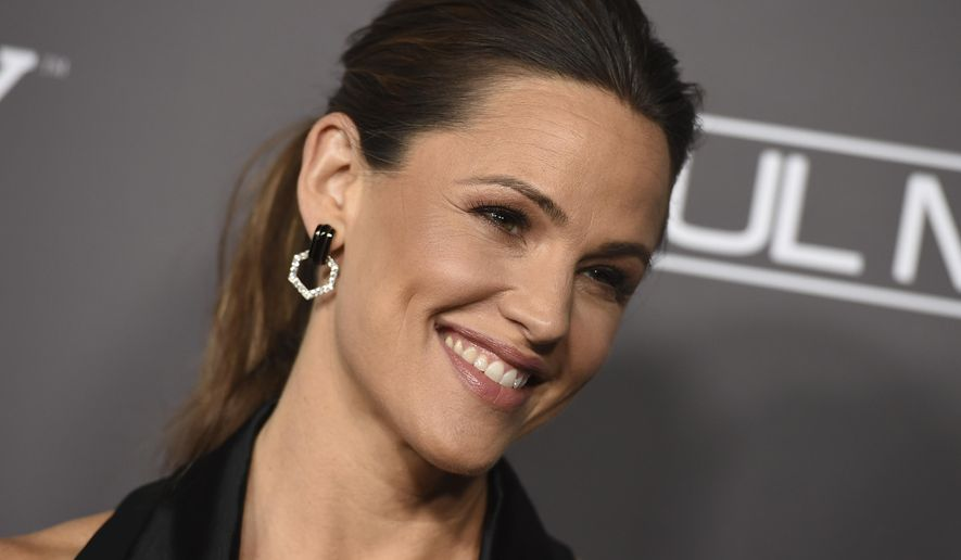 """FILE - In this Nov. 10, 2018, file photo, Jennifer Garner attends the 2018 Baby2Baby Gala in Culver City, Calif. Garner graces the cover of this year's """"Beautiful Issue"""" of People magazine. People revealed the cover Tuesday, April 23, 2019, of the annual issue that hits newsstands Friday. (Photo by Jordan Strauss/Invision/AP, File)"""
