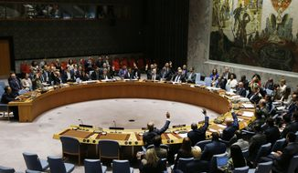 FILE - In this Sept. 11, 2017, file photo, The United Nations Security Council votes to pass a new sanctions resolution against North Korea during a meeting at U.N. headquarters. Some experts say North Korean Kim Jong Un may ask Russian President Vladimir Putin in a meeting set to take place in Vladivostok on Thursday, April 25, 2019, to voice strong opposition to the sanctions, enforce them less stringently and send humanitarian food aid to North Korea. (AP Photo/Jason DeCrow, File)